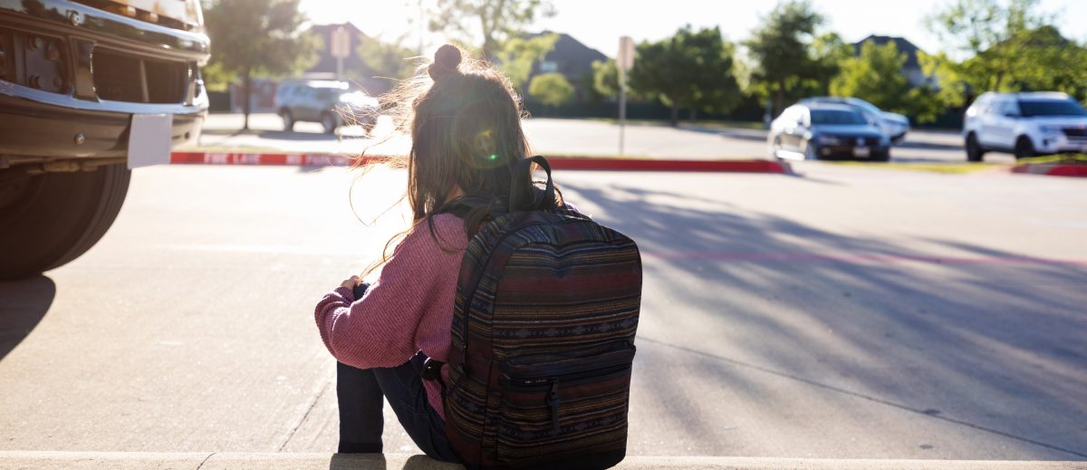 Girl with backpack, homework gap