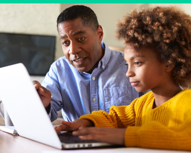 Father and daughter, online classroom