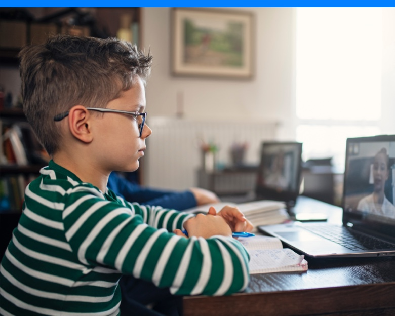 Boy in online classroom with teacher