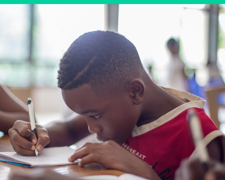 Boy writing, distance learning