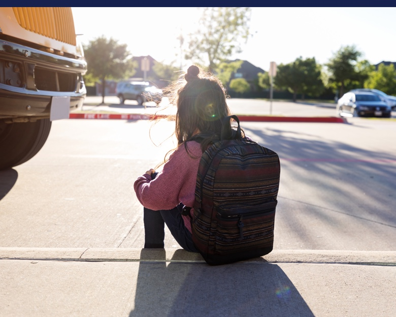 Girl with backpack, outside of school